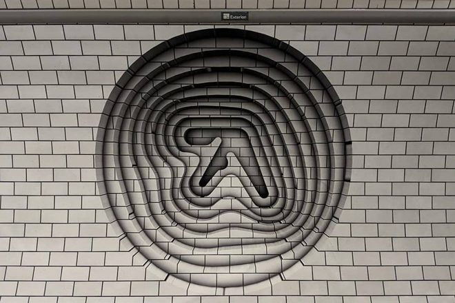 A new 3D Aphex Twin logo has appeared in a London tube station