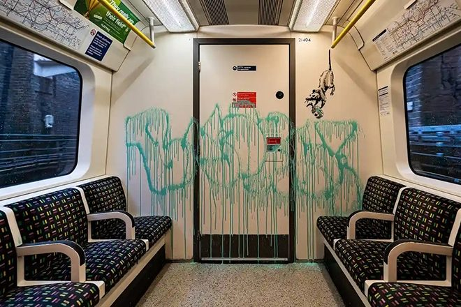 Banksy supports wearing face masks with artwork on the London Underground