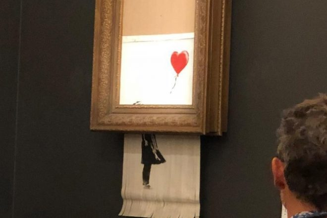 Banksy's painting self-destructs after selling for $1.1 million in auction