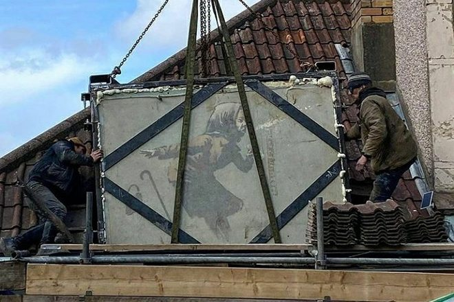 Banksy's sneezing woman mural has been removed from the wall of a house in Bristol