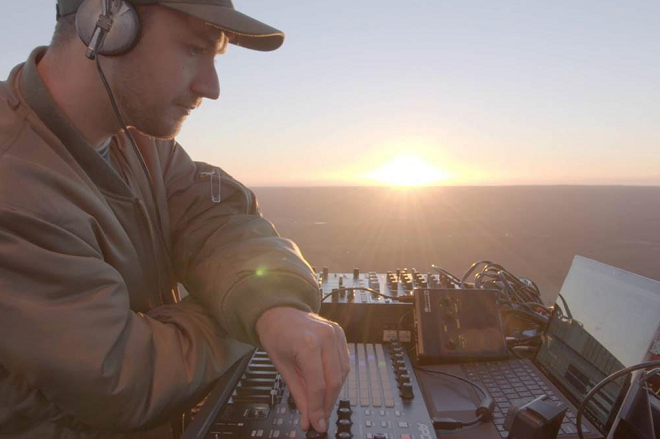 Basenji plays live sunrise set in hot air balloon