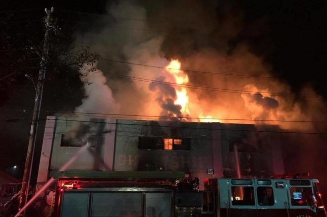 Fire at California warehouse party leaves 36 dead, search continues