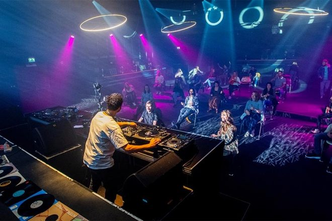 A seated, socially-distanced techno party has taken place in the Netherlands
